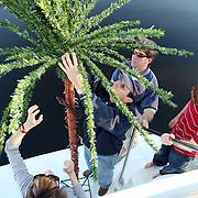 (l-r) Paula DAvis, Ken White, Tucker Stevens, and Drew Stevens prepare and decorate before the North Carolina Holiday Flotilla at Wrightsville Beach...Photo by Logan Mock-Bunting
