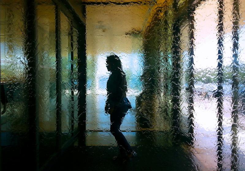 A woman walks into the Swedish House in Washington, D.C. June 8, 2013.