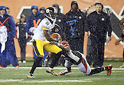 Pittsburgh Steelers wide receiver Martavis Bryant (10) breaks a tackle attempt by Cincinnati Bengals defensive end Michael Johnson (90) during the NFL AFC Wild Card playoff football game against the Cincinnati Bengals on Saturday, Jan. 9, 2016 in Cincinnati. The Steelers won the game 18-16. (©Paul Anthony Spinelli)