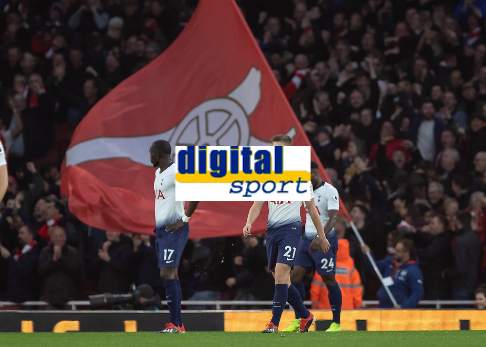 Football - 2018 / 2019 Premier League - Arsenal vs. Tottenham Hotspur<br /> <br /> Dejected Tottenham players troop back to their positions as the giant Arsenal flag waves in celebration at The Emirates.<br /> <br /> COLORSPORT/DANIEL BEARHAM