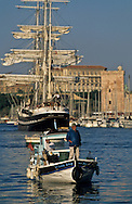 = Fisherman in the old port   in the background the belem boat  France     /// pecheur arrivant au  vieux port , trois mats le Belem ,marseille France  +
