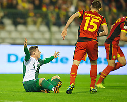 BRUSSELS, BELGIUM - Tuesday, October 15, 2013: Wales' Simon Church appeals for a penalty after being brought down by Belgium's Daniel Van Buyten during the 2014 FIFA World Cup Brazil Qualifying Group A match at the Koning Boudewijnstadion. (Pic by David Rawcliffe/Propaganda)