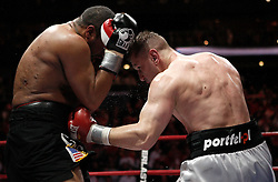 Feb 6, 2010; Newark, NJ; USA; Tomasz Adamek (red/white) and Jason Estrada (black/red) fight a 12-round bout for the IBF Heavyweight International Championship at the Prudential Center.