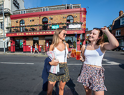 © Licensed to London News Pictures. 23/06/2020. London, UK. Friends celebrate pubs opening soon with a takeaway beer in Barnes in South West London as forecasters predict a hot week ahead with temperatures expected to reach over 30c. Prime Minister, Boris Johnson has announced that tourism and hospitality including pubs, restaurants and campsites can now reopen from the 4th of July as well as reducing the 2 metre rule to 1 metre. Photo credit: Alex Lentati/LNP <br /> <br /> *Permission Given*