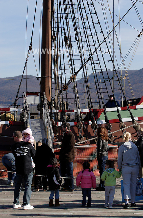 Newburgh, NY - People wait on the dock to take a tour of the Half Moon, a full-scale, operating replica of the Dutch ship of exploration that Henry Hudson sailed in 1609, docked on the Hudson River during the finale of the Newburgh Beacon Bay Quadricentennial celebration on Nov. 7, 2009.