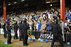 Police keep the fans of the pitch  - Photo mandatory by-line: Dougie Allward/JMP - Tel: Mobile: 07966 386802 04/09/2013 - SPORT - FOOTBALL -  Ashton Gate - Bristol - Bristol City V Bristol Rovers - Johnstone Paint Trophy - First Round - Bristol Derby