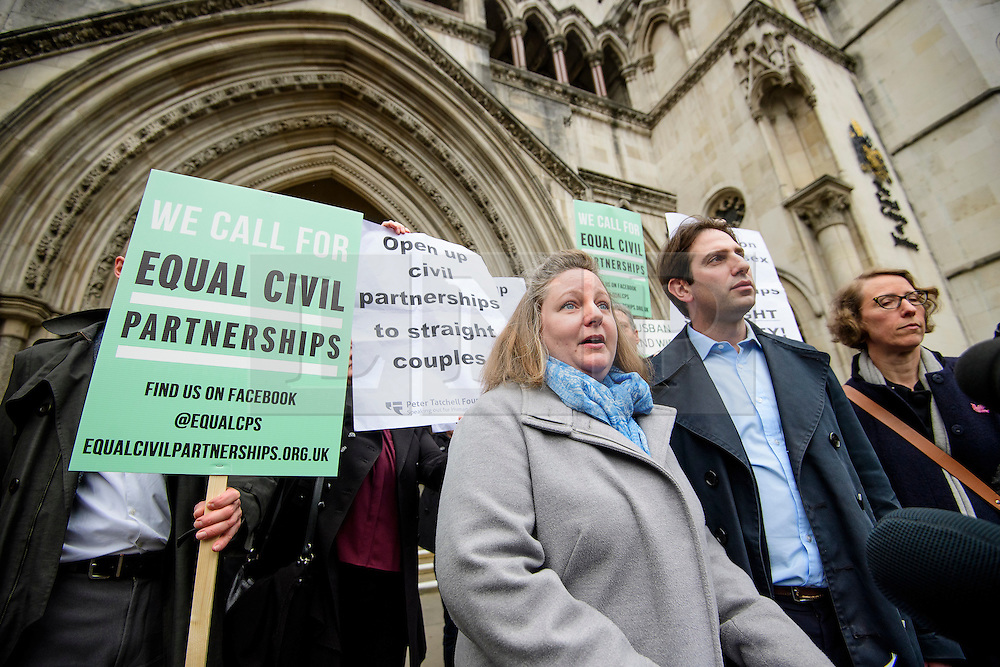 © Licensed to London News Pictures. 21/02/2017. London, UK. Heterosexual couple REBECCA STEINFELD and CHARLES KEIDAN (right) leave the Royal Courts of Justice in London, where a Court of appeal ruled against the heterosexual couple being allowed to enter in to a civil partnership. Photo credit: Ben Cawthra/LNP