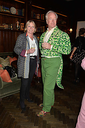 NICHOLAS & VANESSA COURTNEY at the Installation And Reveal Of Gerald Scarfe's Exclusive Artworks In Scarfes Bar at the Rosewood Hotel, 252 High Holborn, London on 7th April 2014.