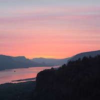 Beautiful pink skies at sunrise, reflect in the water.  Columbia River Gorge, near Cascade Locks, Oregion