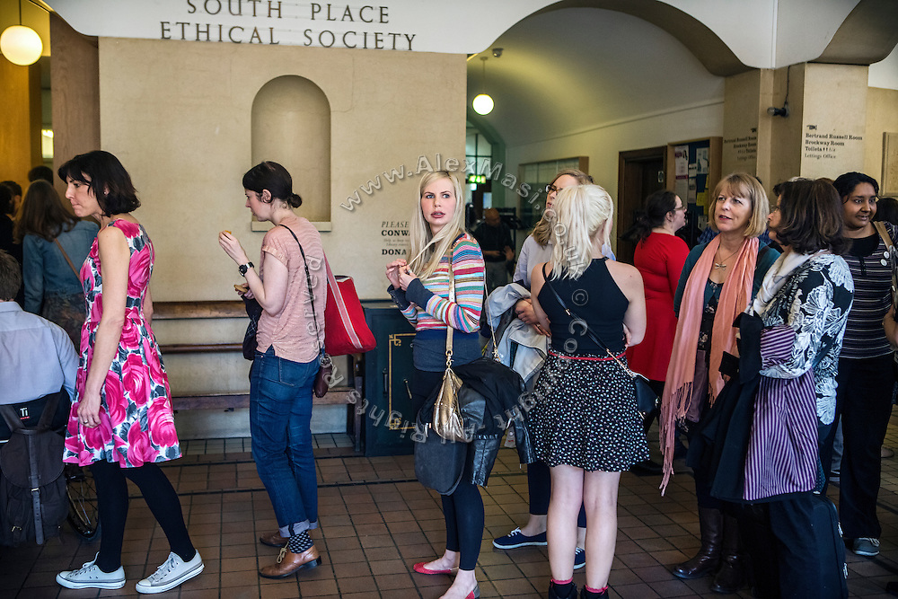 After the congregation, attendees are lining up for tea and biscuits at The Sunday Assembly (today held inside Conway Hall in central London), an atheist service founded by British comedians Sanderson Jones and Pippa Evans in 2013, in London, England. The gathering is designed to bring together non-religious people who want a similar communal experience to a religious church. Satellite assemblies have been established in over 30 cities including New York, San Diego, and Dublin.
