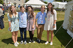 Left to right, LADY ELOISE GORDON-LENNOX, EDWARD SANDY, KHAYA BURKE, CLARA BUCKLEY and ARCHIE BROWNER at the Cartier hosted Style et Lux at The Goodwood Festival of Speed at Goodwood House, West Sussex on 29th June 2014.