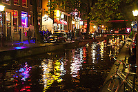 Amsterdam, Holland. Reflections in a canal in the red light district.  The birds in the canal blend in with the colors of the lights.