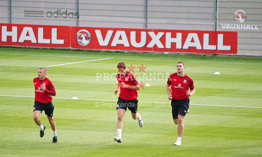 NEWPORT, WALES - Monday, August 12, 2013: Wales' Craig Bellamy, Sam Ricketts and Sam Vokes training at the FAW National Development Centre at Dragon Park ahead of the International friendly against the Republic of Ireland. (Pic by David Rawcliffe/Propaganda)