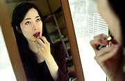 TOKYO TRANSGENDER.Aya while putting on lipstick. Aya has recently come out in the open as a transsexual after many years living her life as a woman. .©: Androniki Christodoulou.