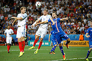 England Forward Jamie Vardy wins a header during the Round of 16 Euro 2016 match between England and Iceland at Stade de Nice, Nice, France on 27 June 2016. Photo by Andy Walter.
