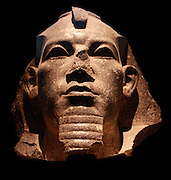 Head from a colossal statue of King Amenemhat III. Twelfth Dynasty, about 1830 BC from Bubast. The massive head comes from one of a pair of colossal statues set up in the temple of the cat-goddess Bastet at the city of Bibastis in the Nile delta. It shoes the severe style of the late Twelfth Dynasty, and the striking appearance would have been enhanced by the inlaid eyes originally fitted in the sockets.