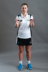 Umpire Kate Mann signalling obstruction of player with ball