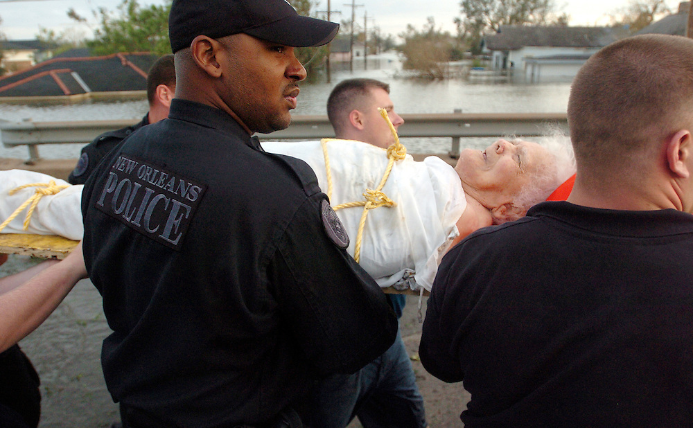 (8/29/2005) New Orleans police officers carry away Audrey Thompson, 91, after she was rescued from the Lower 9th Ward of New Orleans after Hurricane Katrina landed the day before.  Rescuers worked long hours to save the lives of the the residents of the Lower 9th Ward. (Times photo by Willie J. Allen Jr.)