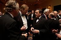 """20 NOV 2003, NEW YORK/USA:<br /> Gerhard Schroeder, SPD, Bundeskanzler, im Gespraech mit Spitzenvertretern der Wirtschaft, waehrend einem Empfang vor einer Festveranstaltung des American Institute for Contemporary German Studies anl. der Verleihung des """"Global Leadership Awards"""" Hotel Grand Hyatt at Grand Central<br /> IMAGE: 20031120-03-017<br /> KEYWORDS: Gerhard Schröder, U.S.A., Reise, Smoking<br /> Gespräch"""