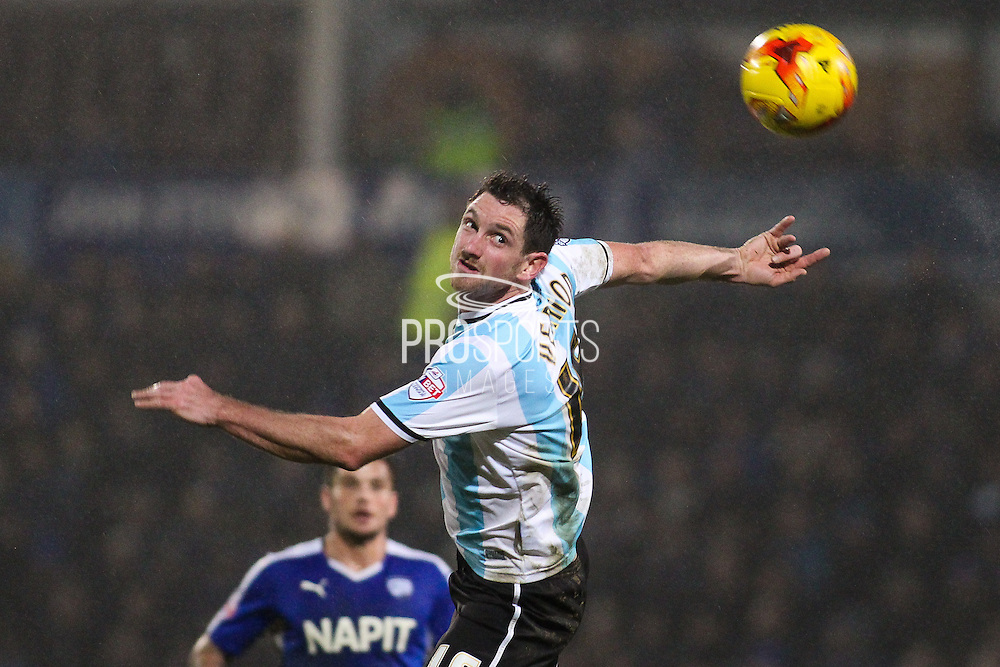 Shrewsbury Town FC forward Scott Vernon wins the ball in the air from Chesterfield FC defender Sam Hird during the Sky Bet League 1 match between Chesterfield and Shrewsbury Town at the Proact stadium, Chesterfield, England on 2 January 2016. Photo by Aaron Lupton.