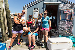 "The crew of lobster buyers, aka the ""Co-op Chicks"" at the Vinalhaven Fishermen's Co-op in Vinalhaven, Maine. Back row, left to right: Abby Harris, Karen Krager, Veronica Ames(boss). Front row, left to right: Emilia Doak, Kirsten Barcon, Katilyn Willis."