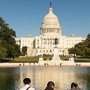West facade of the Capitol Building and reflecting pool in Washington DC