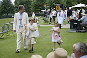 Geordie Greig with his children: Octavia ( pink) Monica ( Blue) and Jasper. Guy Leymarie and Tara Getty host The De Beers Cricket Match. The Lashings Team versus the Old English team. Wormsley. ONE TIME USE ONLY - DO NOT ARCHIVE  © Copyright Photograph by Dafydd Jones 66 Stockwell Park Rd. London SW9 0DA Tel 020 7733 0108 www.dafjones.com