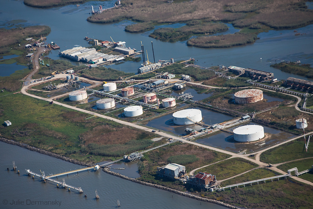 An aerial view of and oil and gas inudstry site in Plaquemines Parish on the banks of the Mississippi River, reveals the disappearing remains of its coastal lands.The Louisiana coast loses a football field's worth of land every 38 minutes. This staggering rate of land loss has been brought on by climate change,  subsidance. and coastal erosion accelerated by human activities, including water diversion projects and damage done by the oil and gas industry.