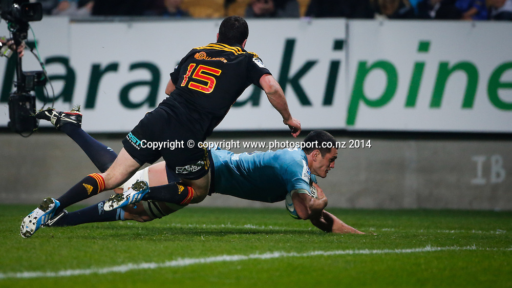 Waratahs Dave Dennis dives in to score a try as Chiefs Tom Marshall attempts a tackle. Super Rugby, Chiefs v Waratahs, Yarrow Stadium, New Plymouth, New Zealand. Saturday, 31 May, 2014. Photo: John Cowpland / photosport.co.nz