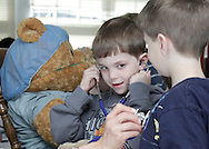 Scotchtown Avenue Elementary School kindergarten student Max Lederman uses a stethescope to listen to the heartbeat of of classmate Matthew Barbrack during a Teddy Bear Clinic at the school in Goshen on Wednesday, April 14, 2010. Staff from Excel Urgent Care examined and treated injured stuffed animals at the clinc. The children also got to sit inside an ambulance from Mobile  Life Support Services. The program, now in its second year of visiting elementary schools in the Hudson Valley, is designed to make the children more comforatable with medical care.