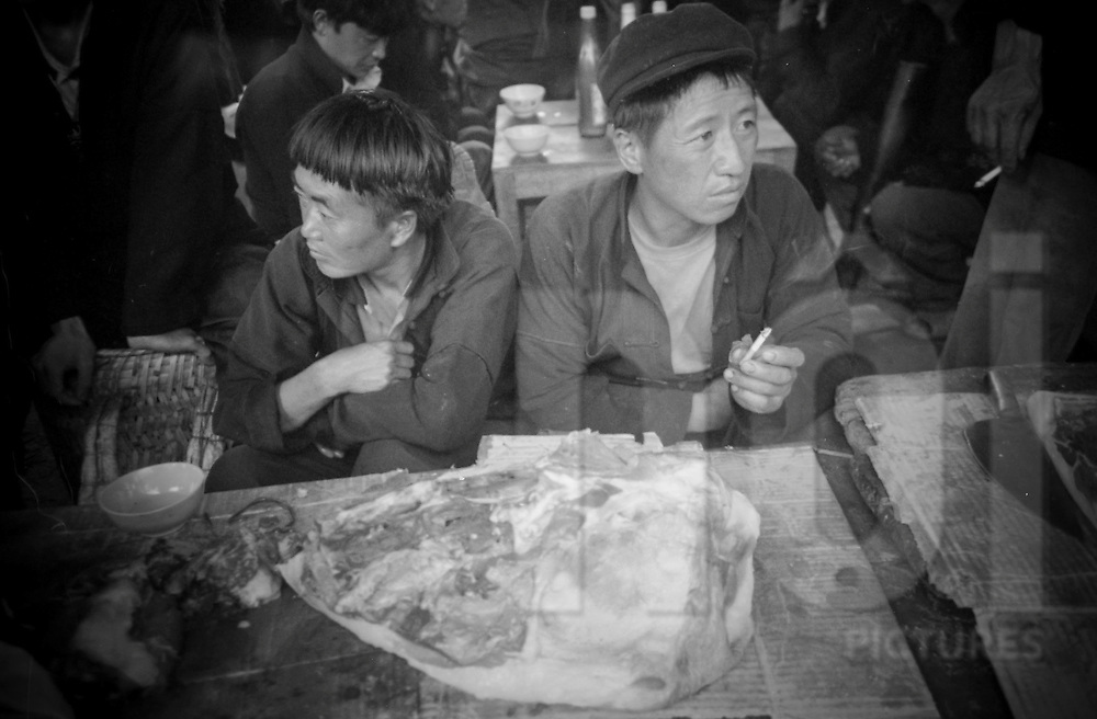 Two Vietnamese butcher men at Xa Phin market, Ha Giang Province, Vietnam, Southeast Asia