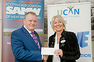 Scottish Association of Meat Wholesalers presentation of cheques to 3 charities at Parklands Hotel, Perth, 28th September, 2016. Allan Jess (President) with Gayle Stephen