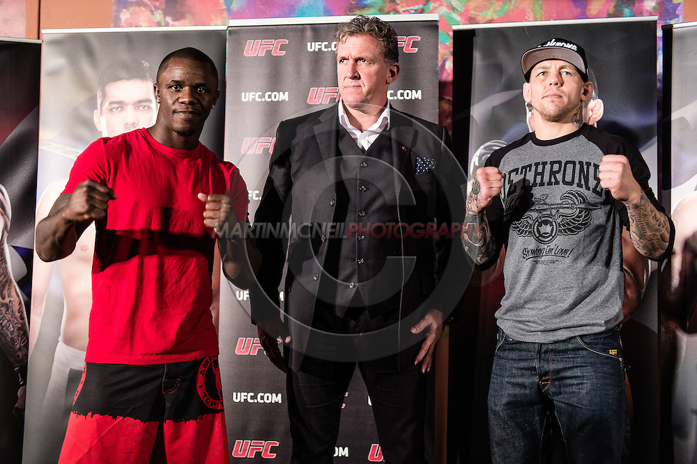 """MANCHESTER, ENGLAND, NOVEMBER 23, 2013: Melvin Guillard and Ross Pearson face off after the media open work-out sessions for """"UFC Fight Night 30: Machida vs. Munoz"""" inside Bierkeller Shooter's Sports Bar in The Printworks, Manchester (Martin McNeil for ESPN)"""