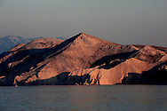 Evening light on the rocky island of Prvic, just off the southern tip of the island of Krk near Baska, Croatia