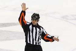 Feb 10, 2012; San Jose, CA, USA; NHL referee Brian Pochmara (16) during the first period between the San Jose Sharks and the Chicago Blackhawks at HP Pavilion. San Jose defeated Chicago 5-3. Mandatory Credit: Jason O. Watson-US PRESSWIRE
