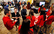 Target recruiters talk with job candidates Briana McShane (L) and Tanner Keyfauber (C) at a job fair in Golden, Colorado June 7, 2016. REUTERS/Rick Wilking