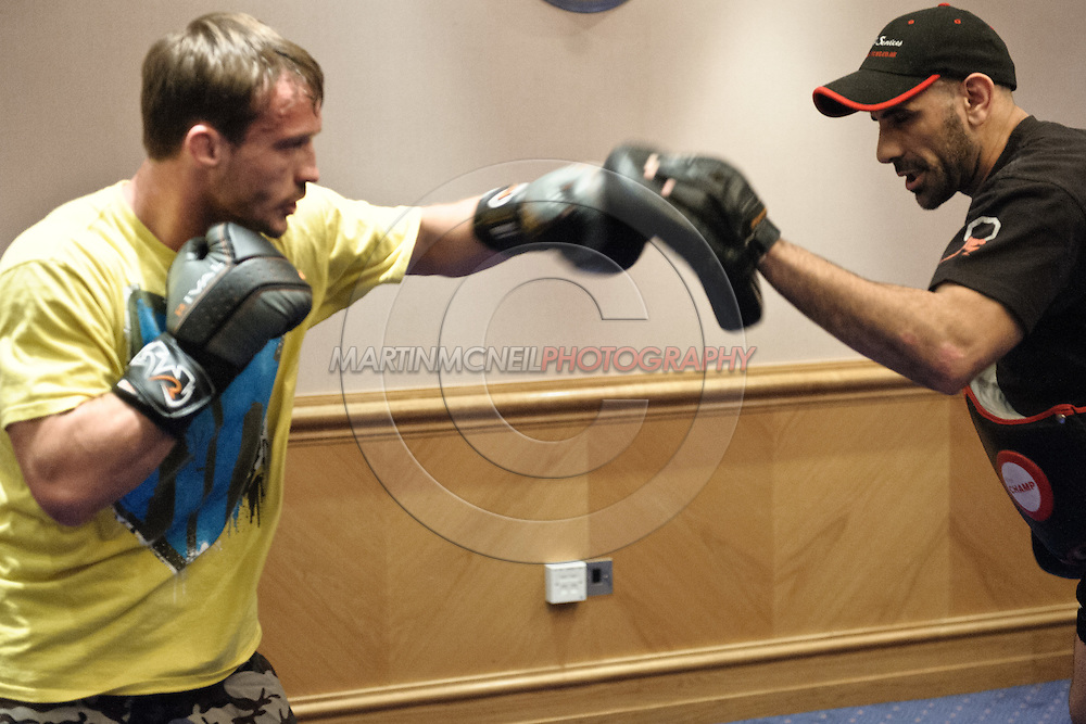 BIRMINGHAM, ENGLAND, NOVEMBER 2, 2011: Brad Pickett (left) works on his striking at the media open work-out sessions inside the Hilton Hotel on November 2, 2011.