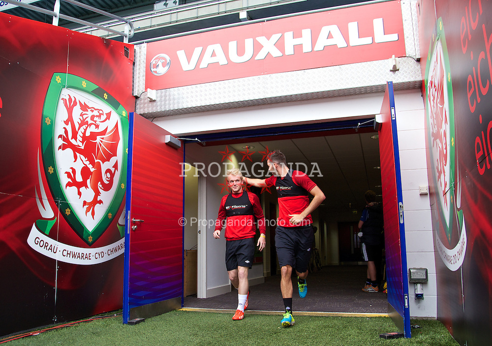 CARDIFF, WALES - Tuesday, August 13, 2013: Wales' Jonathan Williams and Joe Ledley during a training session at the Cardiff City Stadium ahead of the International Friendly match against the Republic of Ireland. (Pic by David Rawcliffe/Propaganda)