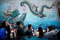 Cynthia Yee stops the tour at the dragon mural on Clay and Grant streets to read Chinese zodiacs descriptions of each person in the group, in San Francisco, Ca., on Friday, June 18, 2010.