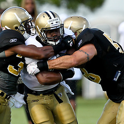 August 9, 2011; Metairie, LA, USA; New Orleans Saints running back Mark Ingram runs through defenders during training camp practice at the New Orleans Saints practice facility. Mandatory Credit: Derick E. Hingle
