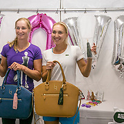 August 25, 2016, New Haven, Connecticut: <br /> Elena Vesnina of Russia and Elina Svitolina of Ukraine go shopping at the sponsor booths during Day 7 of the 2016 Connecticut Open at the Yale University Tennis Center on Thursday, August  25, 2016 in New Haven, Connecticut. <br /> (Photo by Billie Weiss/Connecticut Open)