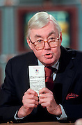 U.S. Senator Daniel Patrick Moynihan holds a copy of the US Constitution as he discusses the possible Senate trial of President Clinton following his impeachment by the House during NBC's Meet the Press December 27, 1998 in Washington, DC.