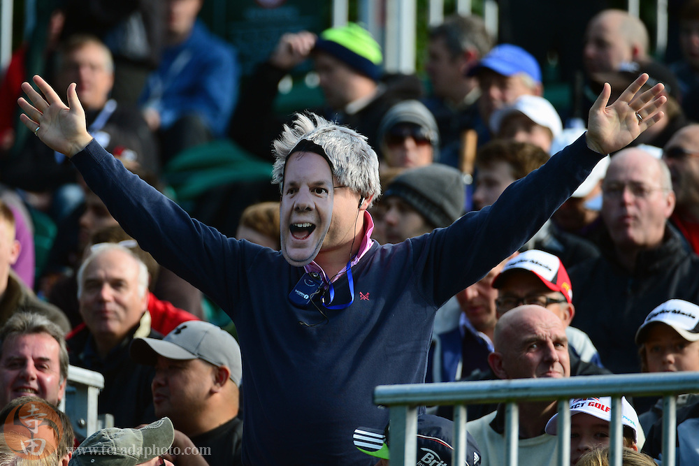 July 20, 2012; St. Annes, ENGLAND; A fan wearing a mask stands in the grandstand of the 1st tee during the second round of the 2012 British Open Championship at Royal Lytham & St. Annes Golf Club.