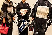 JAPAN - YOKOHAMA - National museum's concert hall, three women wear black kimono with white obi [FR] Trois femme portent des kimono noir de soirée avec le obi blanc, dans la salle de concert du musée national