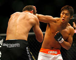 March 1, 2008; Columbus, OH; UFC 82: Pride of a Champion -  Yushin Okami (white/orange trunks) knocks out Evan Tanner (black trunks) with a knee in the third round of their bout at the Nationwide Arena in Columbus, OH.