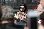 March 15, 2014 - Roosevelt Island, NY. Ukrainian Supporter shows her disapproval of Vladimir Putin's tactics with this doctored photograph of Putin resembling Adolf Hitler. 03/15/2014 Photograph by Elijah Stewart/NYCity Photo Wire