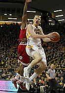 December 31 2012: Indiana Hoosiers guard Kevin Ferrell (11) tries to block a shot by Iowa Hawkeyes forward Aaron White (30) during the first half of the NCAA basketball game between the Indiana Hoosiers and the Iowa Hawkeyes at Carver-Hawkeye Arena in Iowa City, Iowa on Monday December 31, 2012. Indiana defeated Iowa 69-65.