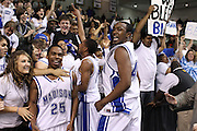(l to r) A. J. Butler, Jerel Carter, and Logan Terrell celebrate with the student section following Madison's State Championship win.  Date:  March/12/10, Madison boy's basketball team brought home the State Championship tonight defeating the Altavista Colonels 41-38.  Leading Madison were Logan Terrel, David Falk, and Jerel Carter with 10 points each.