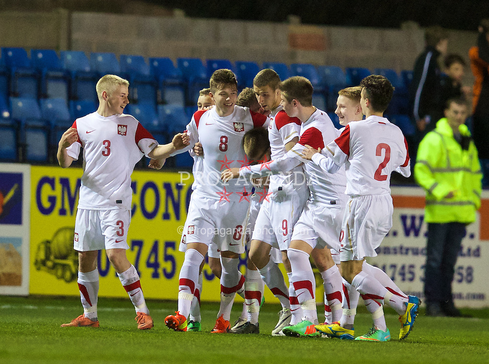 RHYL, WALES - Tuesday, March 18, 2014: Poland's Jakub Obloj [centre] celebrates scoring the second goal against Wales during the Under-15's International Friendly match at Belle Vue. (Pic by David Rawcliffe/Propaganda)