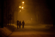 Pedestrians brave the blizzard conditions of Winter Storm Nemo as snow falls on Cedar Street in Somerville, Massachusetts, U.S., on Friday, Feb. 8, 2013. The storm is expected to dump upwards of 2 feet of snow on the region overnight. Photographer: Kelvin Ma/Bloomberg